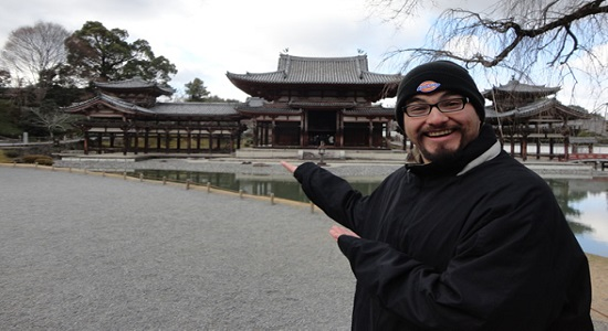 Enrique Munoz, a previous SDSU Gilman Scholar recipient, stands in front of the Byodo-In Temple in J