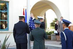 A color guard presents and raises the U.S. flag at a new pole installed adjacent to the Veterans Center.