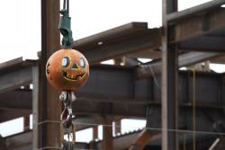 The Aztec Student Union construction crew gets in the Halloween spirit by painting the rigging on the crane. Photo by: Vic Ly, A.S.