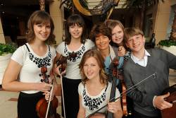 "While living in Florida, Julie Bunnell heard a particularly talented violinist and decided that her children, when she had them, would play the violin.  Julie did not play an instrument, but her guidance and discipline at home helped cultivate the musical talents of her children. ""She always knew when we made a mistake,"" Ross said."
