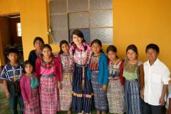 An SDSU undergraduate student and Guatemalan elementary school students dressed in native dance attire.