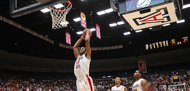 Kawhi Leonard dunks with authority to seal the Aztecs 71-64 double-overtime win vs. Temple. Photo by Ernie Anderson.