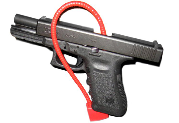 Glock 17 with a cable lock (Credit: Wikimedia Commons/Kencf0618)