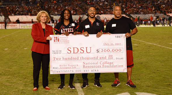 From left to right: SDSU President Sally Roush, NCRF president Theresa Price, Chase Price ('15) and Ricky Price