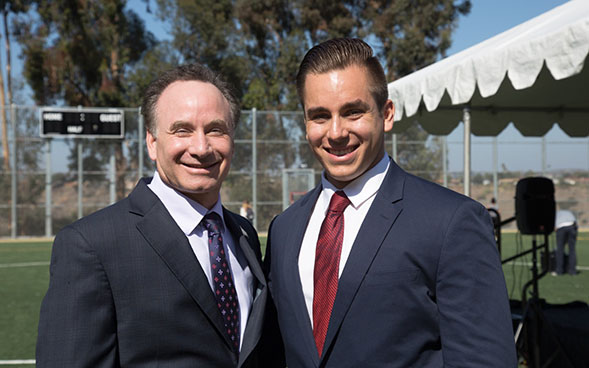 Christopher Thomas (right) poses for a photo with SDSU President Elliot Hirshman.