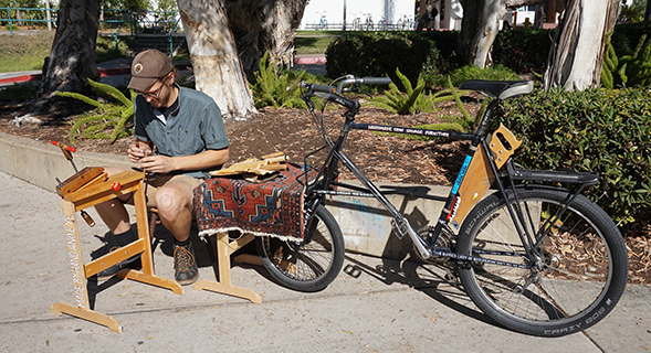 Peter Scheidt, Kurb-Side Spoons, 2017 (pictured: the artist working); modified Specialized Stumpjumper; courtesy of the artist