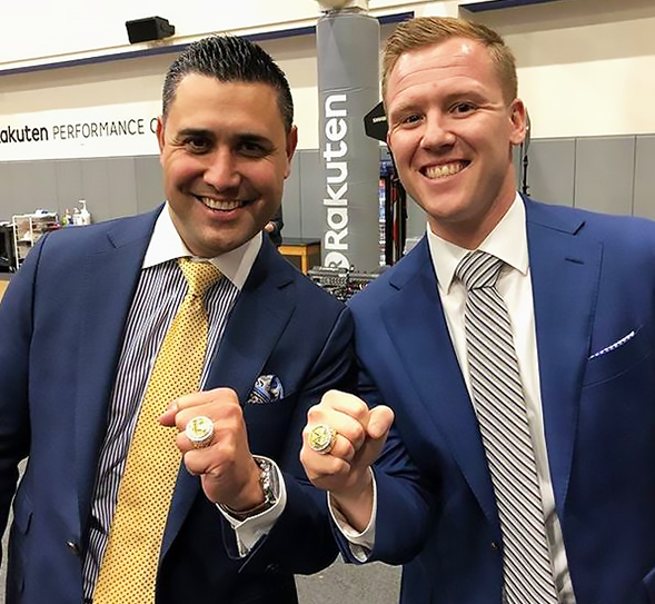 Mike Kitts (left) and Dominic Lucq show off their 2017 NBA Championship rings.