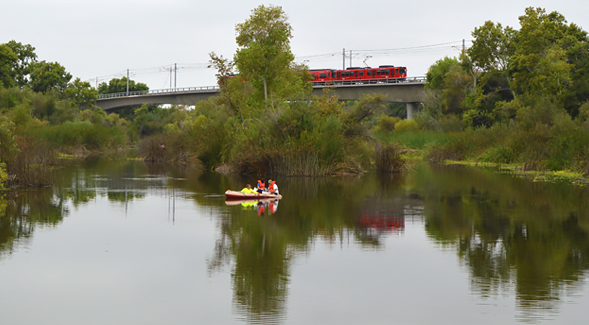 Trent Biggs and colleagues take water samples on the San Diego River in Mission Valley.