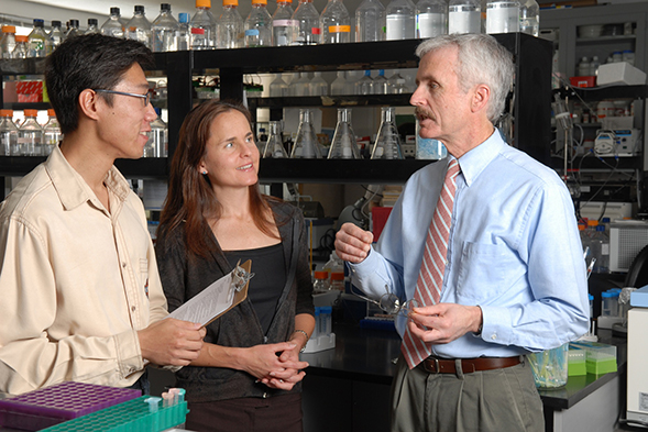 Chris Glembotski (right) with postdoctoral fellow Jungkang Jin (left) and research associate Marie Marcinko (center).