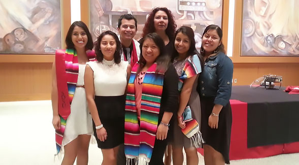 Cynthia Torres with graduating students