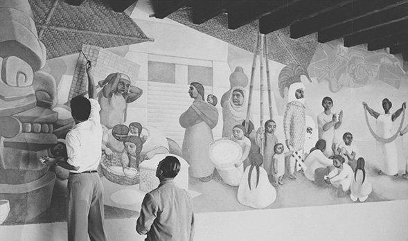 "Robert Hugenberger painting his ""Market"" mural under the supervision of SDSU art professor Lowell Houser in 1949. (Courtesy: K. Lyle Hugenberger)"
