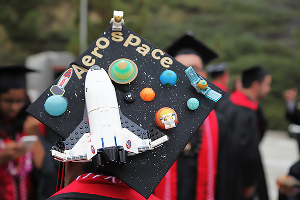 SDSU invites graduating students to share the originality and creativity of their decorated commencement caps.