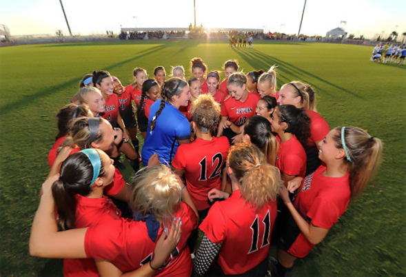 The SDSU women's soccer team huddles together before a game. (Photo: Ernie Anderson)