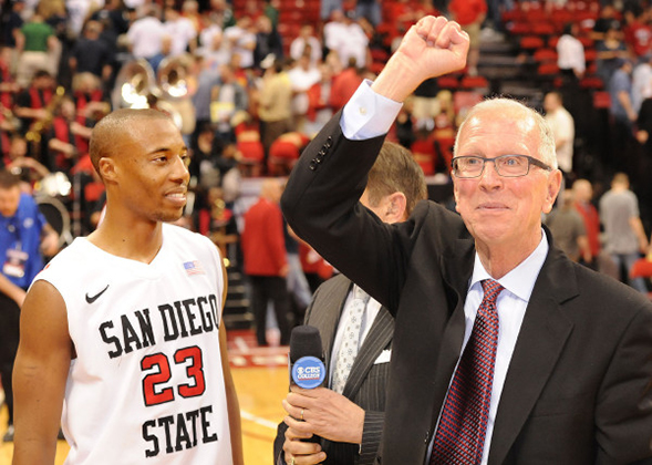 Former SDSU basketball player D.J. Gay (left) and former head coach Steve Fisher celebrate a win during the 2011 Mountain West Tournament. (Credit: GoAztecs)