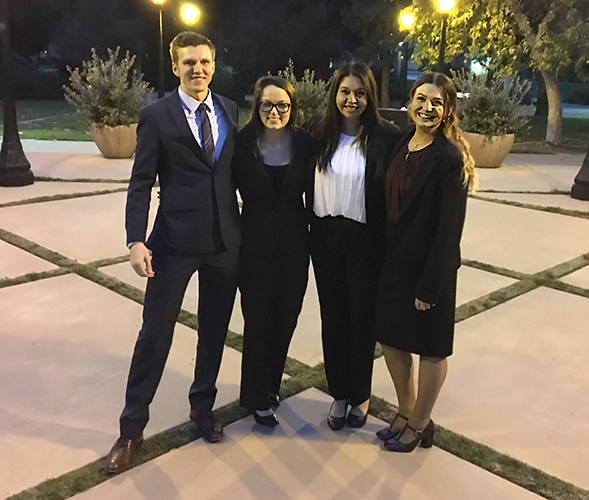 From left to right: Connor Hume, Megan Hanson, Gaby Rosales and Kat Hupke at the American Mock Trial Association Regional Tournament.
