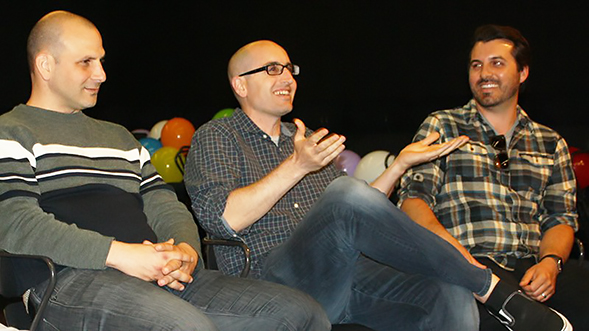 From left to right: Ron Najor ('99, '02), Justin Halpern ('03) and Mike Rizzi ('03) speak with students interested in television and film careers.