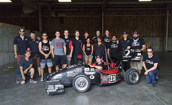 Members of Aztec Racing pose at the Formula SAE Lincoln 2016 competition in Lincoln, Neb. (Credit: Aztec Racing)