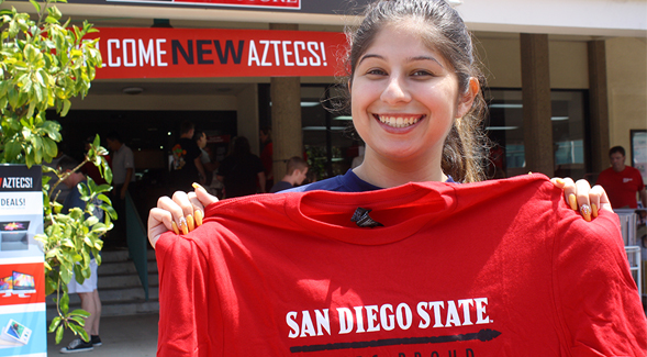 New student donors receive a lanyard and an Aztec Proud T-shirt.