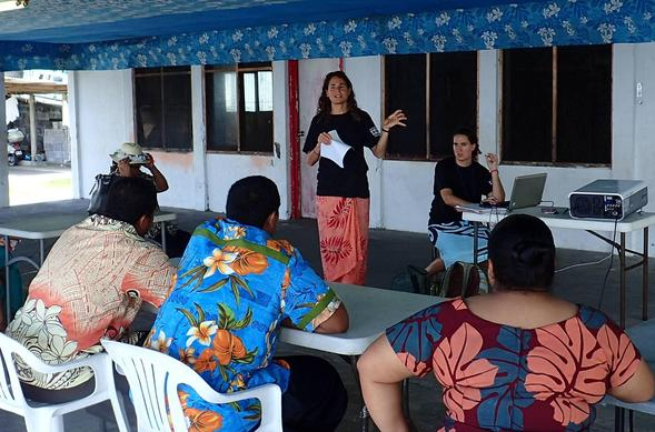 SDSU assistant professor of geography Arielle Levine (standing) facilitates a mapping workshop in American Samoa. (Photo courtesy of Arielle Levine)