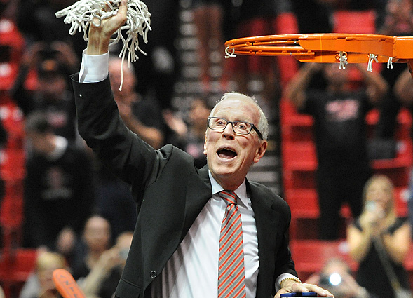 Coach Steve Fisher cuts down the net.
