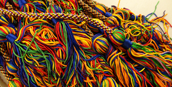 Graduates receive a rainbow cord to wear as part of their commencement regalia.