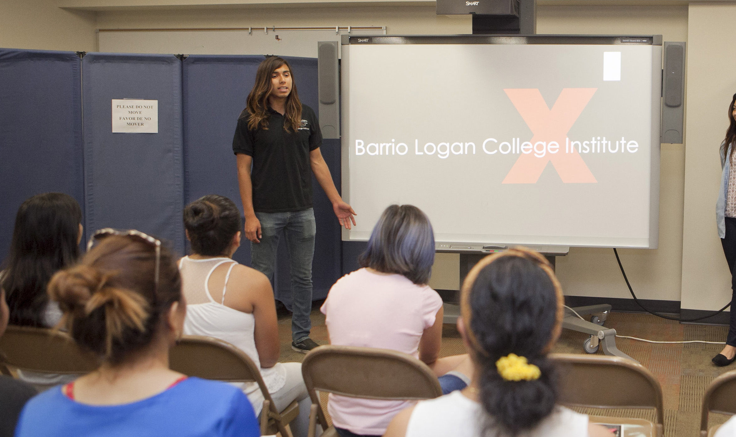 Francisco Martinez presenting to Barrio Logan College Institute students