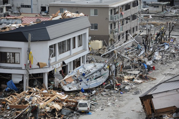 US Navy Photo: A fishing boat is among debris in Ofunato, Japan, following a 9.0 magnitude earthquake and subsequent tsunami
