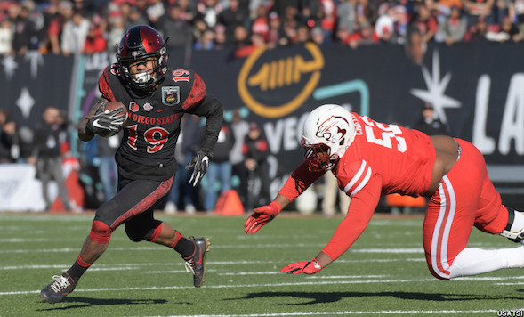 Aztec running back Donnel Pumphrey became college football's all-time leading rusher with 6,405 yards.