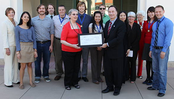 Robin Luby, president of the local Achievement Rewards for Colleges Scientists chapter, presents SDSU a ceremonial check in support of science and engineering scholarships for students.