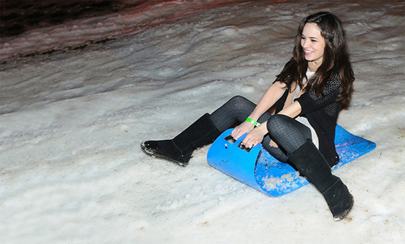 A student enjoys the snow at the 2013 Aztec Nights event.