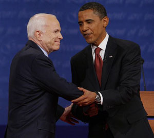 Then presidential candidates Barack Obama and John McCain shake hands before a debate in 2008.