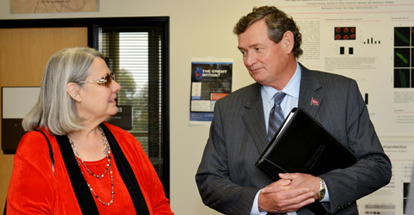 CSU Chancellor Timothy P. White and philanthropist Darlene Shiley chat during a tour of the Donald P. Shiley BioScience Center. (Photo: diFranco Photography)