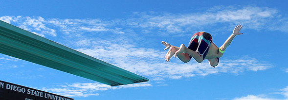 An Aztec Recreation member jumping off the high dive.