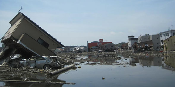 The exhibit explores damage caused by the tsunami in Kesennuma, Japan and the effort to rebuild.