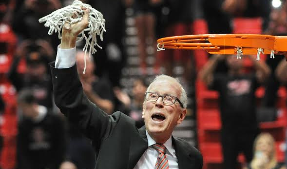 Steve Fisher cuts down the net after beating New Mexico for the Mountain West Championship game. Photo courtesy of Ernie Anderson.