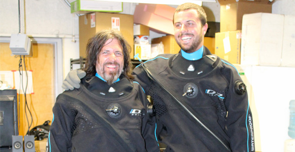 Forest Rohwer (left) and Steven Quistad try on dry suits in preparation for their trip to the Arctic.