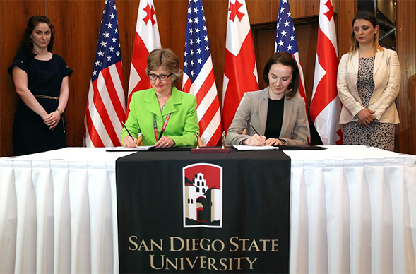 Former SDSU Provost Nancy Marlin and Georgia's  Minister of Education and Science, Tamar Sanikdize signing the agreement to launch SDSU-Georgia.