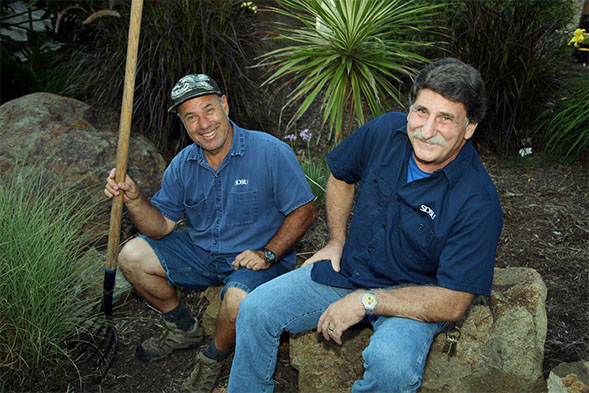 Robert Humphus, left, and Charles Barranco are among the staff who maintain the SDSU campus.