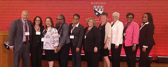 Trish Hatch (third from right) and Laura Owen (fifth from right) at Harvard.