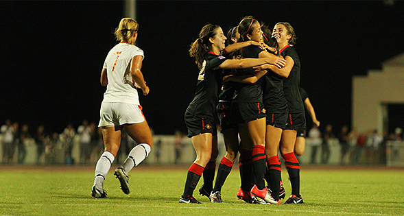 The SDSU women's soccer team celebrates after a goal.