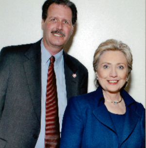 SDSU Police Detective Chris Jacobsen stands with Hillary Clinton during her 2008 presidential campaign event at SDSU.