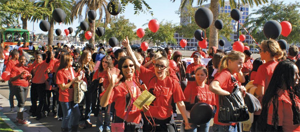 Members of the SDSU community marching in the 2013 MLK Parade.