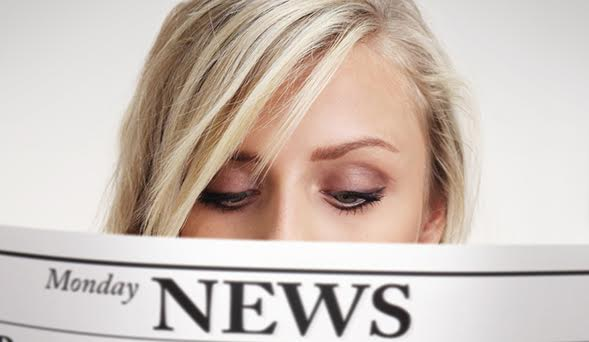 A woman reading the news
