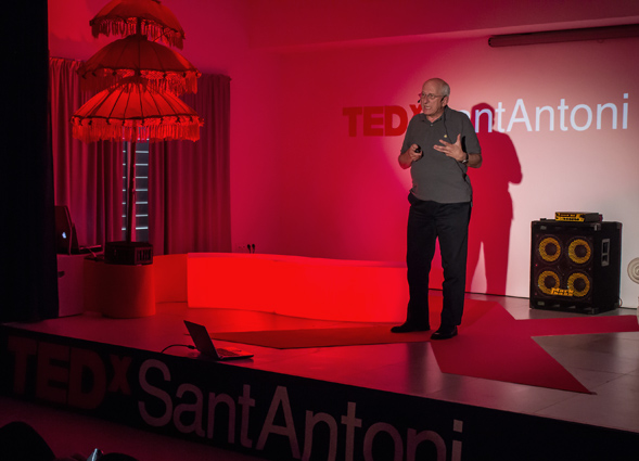 Tom Novotny speaks about his research at a TEDx event on the environment in Ibiza, Spain.