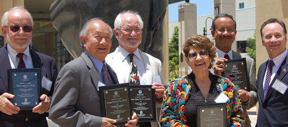 The President's Leadership Fund Faculty and Staff Awards for Excellence winners and representatives stand with SDSU President Elliott Hirshman.