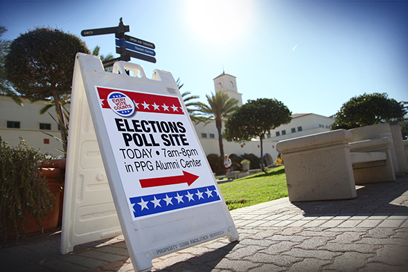 A sign directs people to a polling station at SDSU's Parma, Payne Goodall Alumni Center.