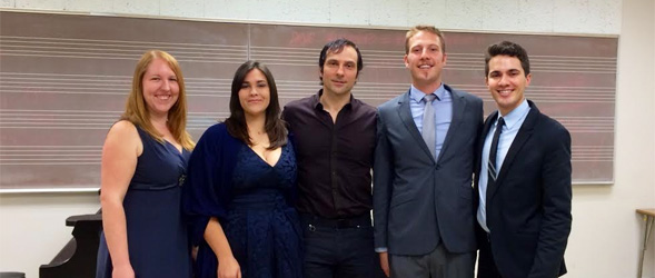 SDSU students pose with David Adam Moore (center), baritone opera professional, after attending his master class.