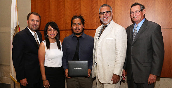 Juarez (center) at the CSU Trustees Award ceremony.