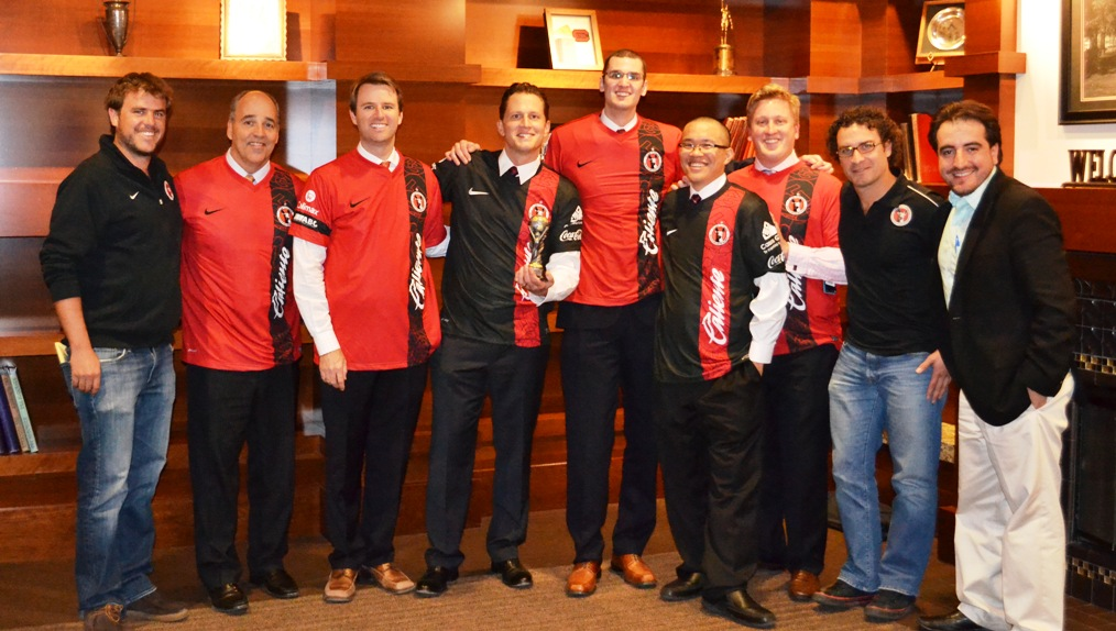 The SDSU Sports MBA Program winning team with College of Business Dean Michael Cunningham and executives from the Xolos.