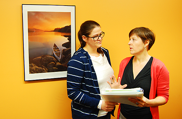 Cathy Cirina-Chiu, right, managing director of the lab, and Dara McIntyre, left, reviewing survey results.